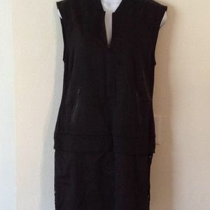 Black athletic dress. With pockets and zippers.